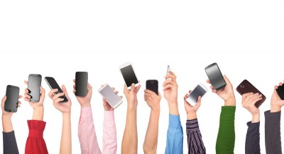 hands holding up mobile phones